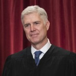 FILE - In this June 1, 2017 file photo Supreme Court Associate Justice Neil Gorsuch is seen during an official group portrait at the Supreme Court Building Washington. Gorsuch's first Supreme Court opinion Monday, June 12, 2017, stayed true to what Gorsuch promised in his nomination hearing and to the reputation for good writing he developed as an appellate judge. (AP Photo/J. Scott Applewhite, File)
